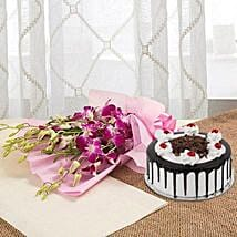 Wondrous Wishes For You - Bunch of 6 purple Orchids and 1 kg Blackforest Cake.