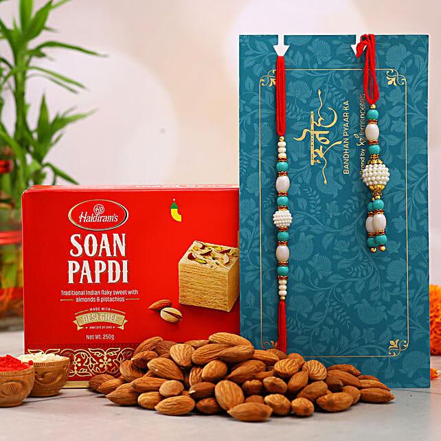 Blue Pearl Lumba Rakhi Set And Almonds With Soan Papdi