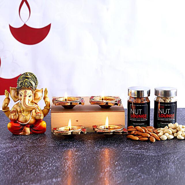 4 Swastik Diyas & Ganesha Idol With Dry Fruits