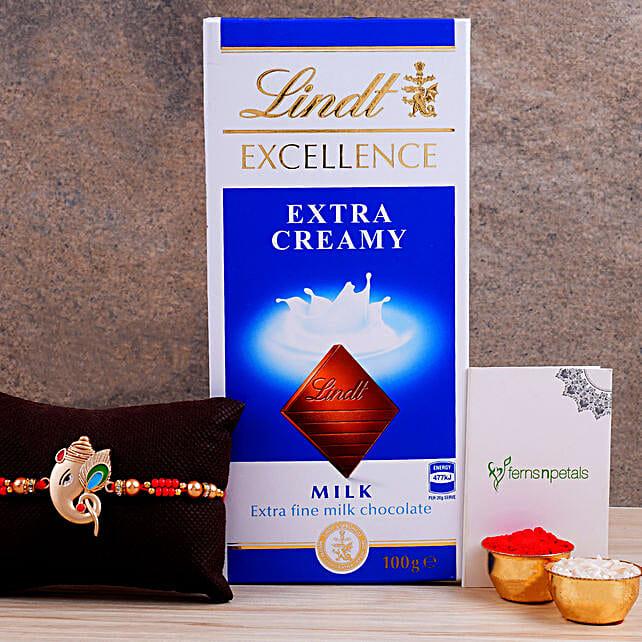 Alluring Silver Ganesha Rakhi And Lindt Chocolate:Rakhi with Chocolates to Netherlands