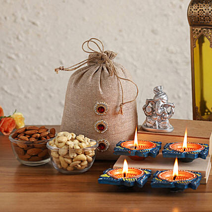 Online Silver Ganesha Idol With Diyas & Dried Nuts Potli