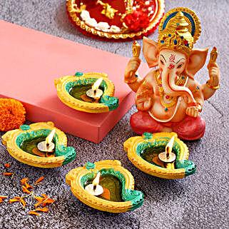 4 Mango Shaped Diyas & Pink Dhoti Ganesha Idol