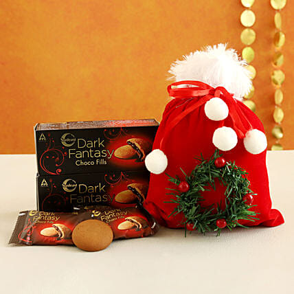 Dark Fantasy Choco Fills In Furry Red Pouch:Christmas Gifts Delivery In Oman