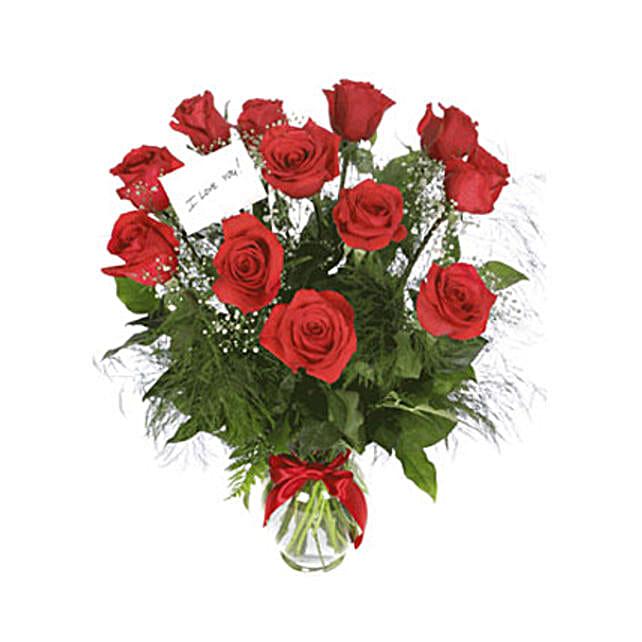Scarlet Elegance:Anniversary Flower Delivery Oman