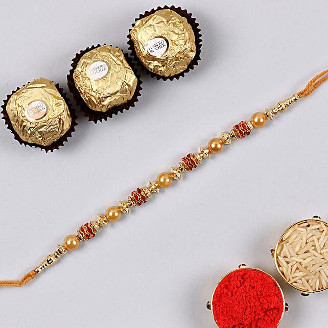 Golden Red Thread Rakhi And 3 Pcs Ferrero Rocher