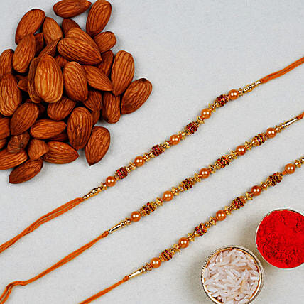 Golden Red Thread Rakhi With Almonds 100 Gms