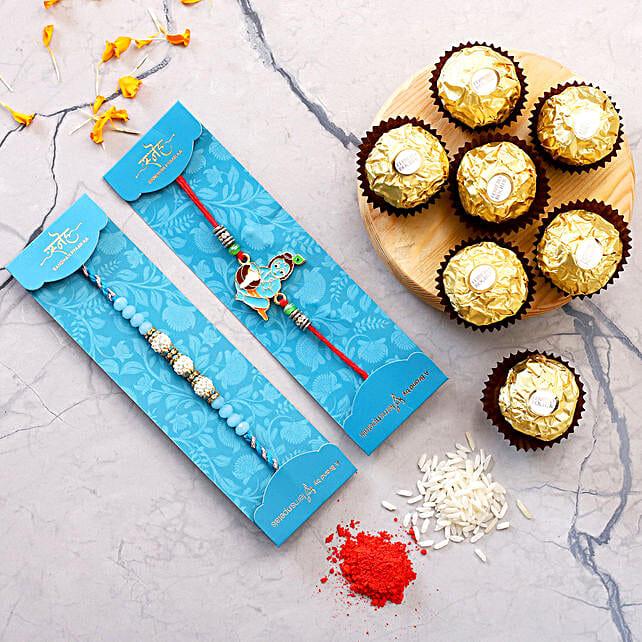 Sea Blue Pearl And Bal Krishna Rakhi Set With 3 Pcs Ferrero Rocher