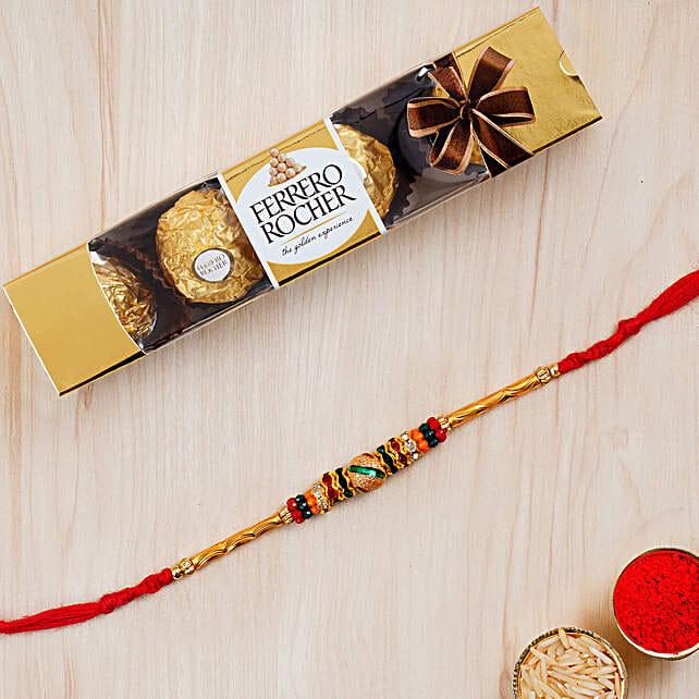 Beautiful Meena Thread Rakhi And 3 Pcs Ferrero Rocher:Rakhi Delivery in Qatar