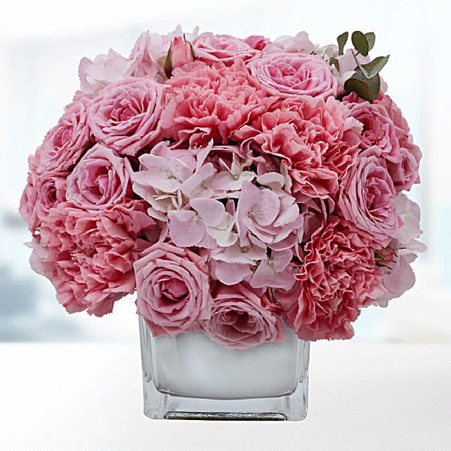 delicate pink blooms in vase online