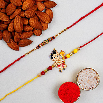 Om And Kid Rakhi With Almonds