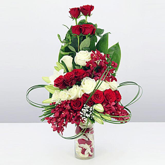floral vase arrangement online:Send Orchid Flowers to Qatar