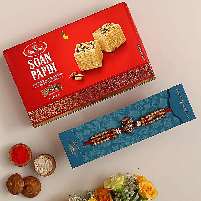 Auspicious Kalash Rudraksha Rakhi And Soan Papdi:Rakhi Delivery in Qatar
