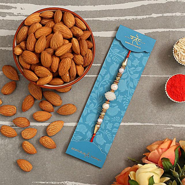 Elegant Pearl Mauli Rakhi And Healthy Almonds:Rakhi with Dryfruits to Saudi Arabia