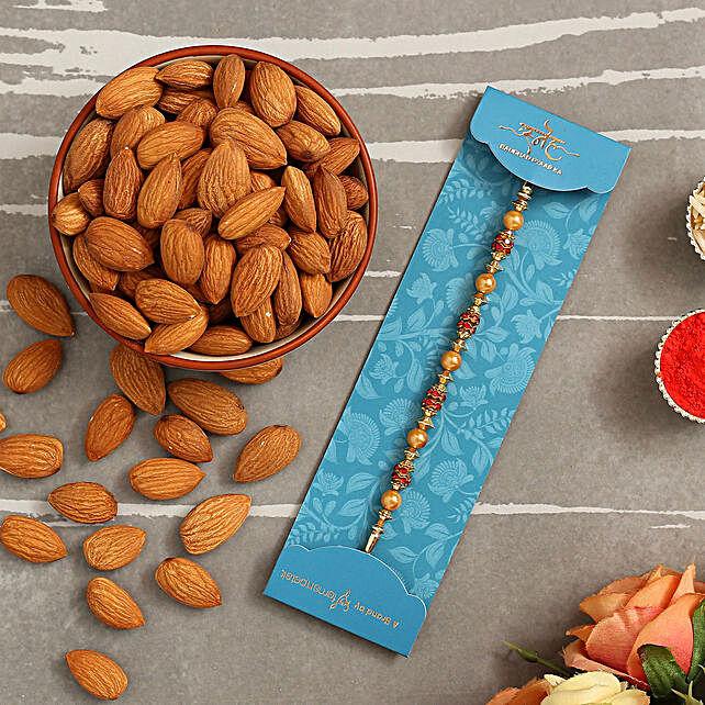 Traditional Golden Pearl Rakhi And Healthy Almonds:Send Rakhi to Saudi Arabia