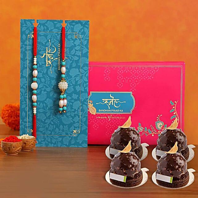 Golden Rocher Pieces With Blue Pearl Rakhi Set