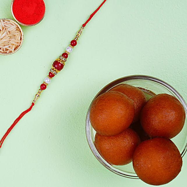 Elegant Pearl Thread Rakhi And Haldiram Gulab Jamun Tin