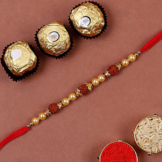 Golden Red Rudraksh Rakhi And 3 Pcs Ferrero Rocher