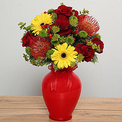 Mixed Flowers in Red Glass Vase Dubai
