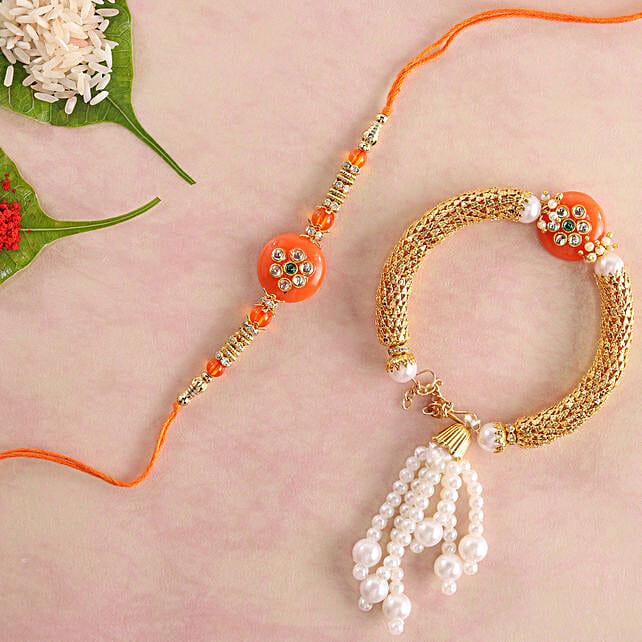 Glittering Orange Lumba Rakhi Set:Rakhi with Greeting Cards to Singapore