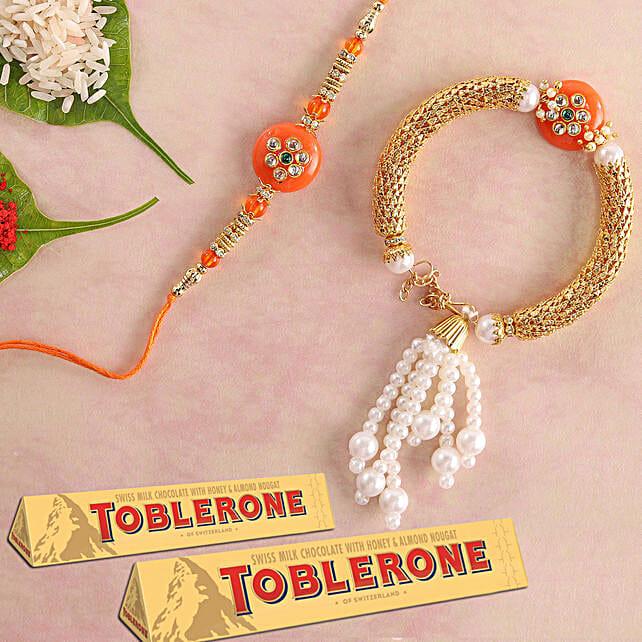 Bhaiya Bhabhi Rakhi Set And Toblerone:Rakhi with Greeting Cards to Singapore