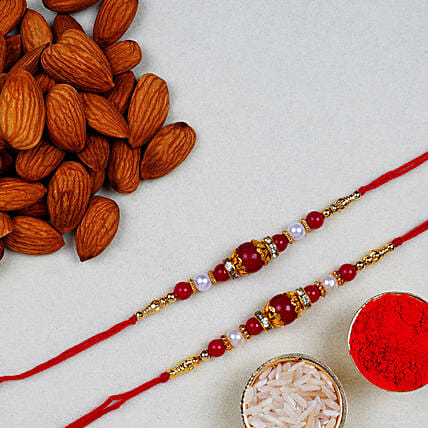 Red Pearl Thread Rakhi With Almonds