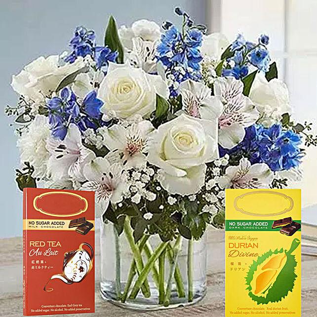 White Flower Arrangement And Chocolates