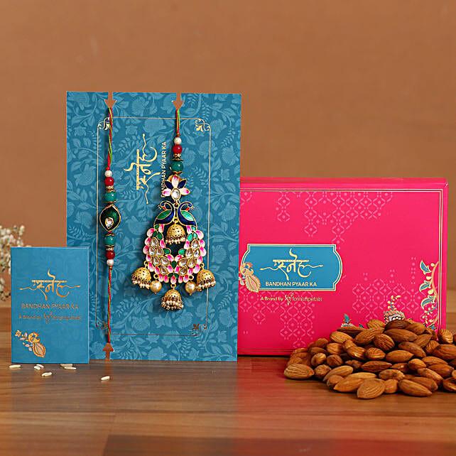 Pink Peacock Lumba Rakhi Set With Healthy Almonds:Rakhi for Bhaiya Bhabhi Singapore