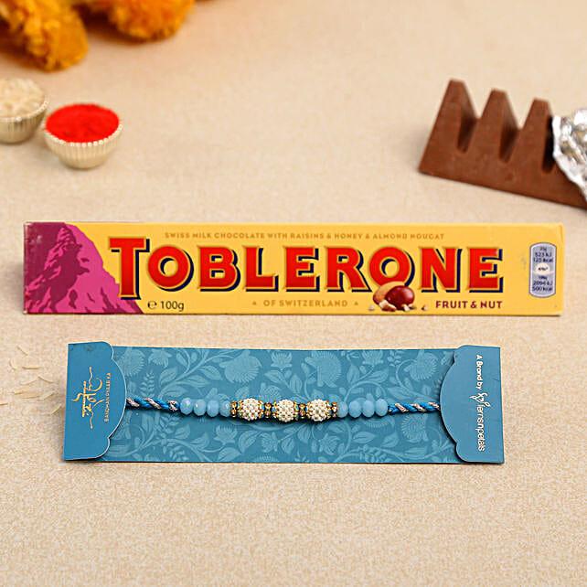 Sea Blue Pearl Designer Rakhi And Toblerone Chocolate
