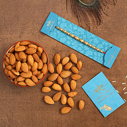 Traditional Pearl Mauli Rakhi And Healthy Almonds:Rakhi Gifts for Brother to Singapore