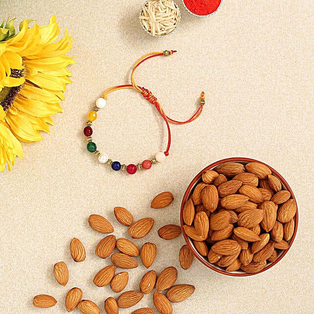 Beautiful Navrattan Rakhi N Almonds Combo:Rakhi and Dry Fruits to Singapore