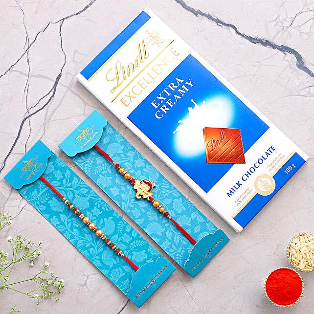 2 Enticing Rakhis N Lindt Chocolate:Send Cartoon Rakhi to Singapore