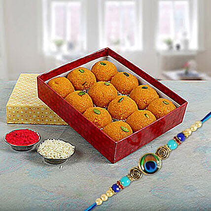 Circular Peacock Feather and Motichoor Laddu:Rakhi Gifts for Brother to Singapore