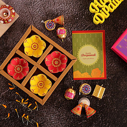 Set Of 4 Flower Diyas And Cracker Shaped Chocolates:Diwali Gift Delivery in Singapore