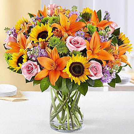 Vibrant Bunch of Flowers In Glass Vase