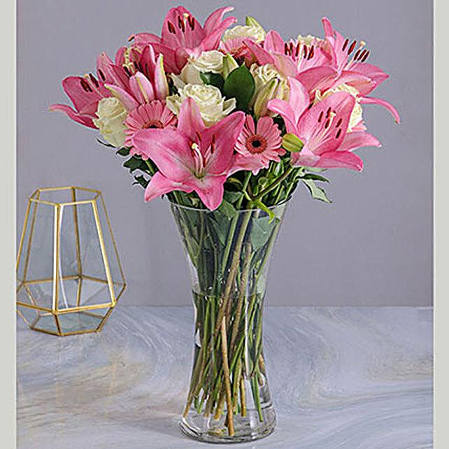 Pastel Seasonal Flowers In A Glass Vase