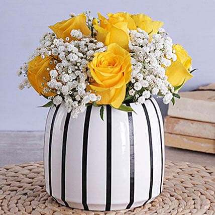 Yellow Roses In A Black And White Vase
