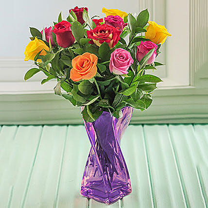 Mixed Roses In A Purple Twisted Vase