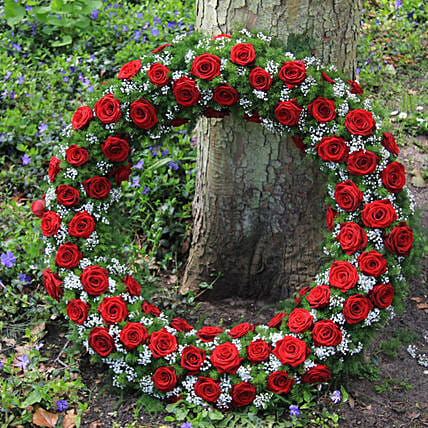 Wreath Of Red Roses:Rakhi Gifts to Sister in Switzerland