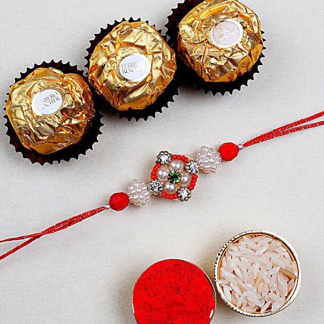 Appealing Floral Rakhi And 3 Pcs Ferrero Rocher