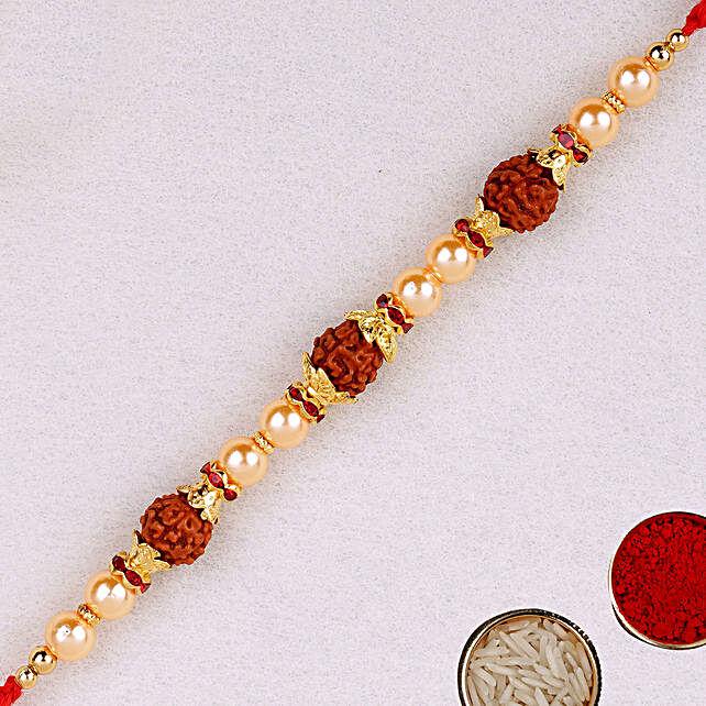 Golden Red Beaded Rudraksh Rakhi:Single Rakhi to UAE