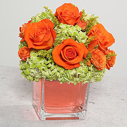 Orange Roses Arrangement In Glass Vase
