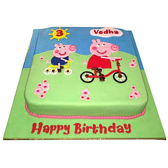 Peppa Pig on a cycle Cake