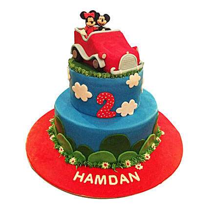 Minnie N Mickey in a car Cake