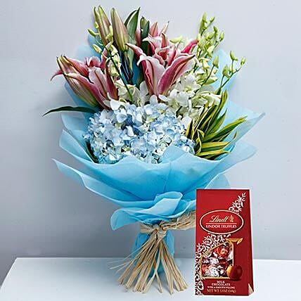 Delicate Flowers and Lindt Chocolate Combo:Order Lilies in UAE
