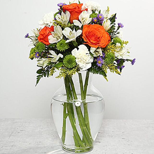 Orange Roses In Glass Vase