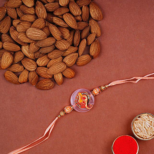 Ganesha Rakhi And Almonds Combo