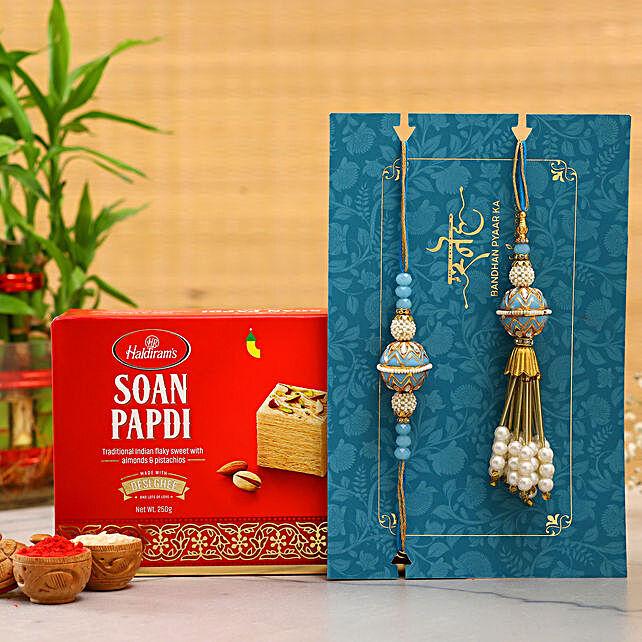 Blue Orb Pearl And Lumba Rakhi Set With Soan Papdi:Send Ethnic Rakhi to UAE