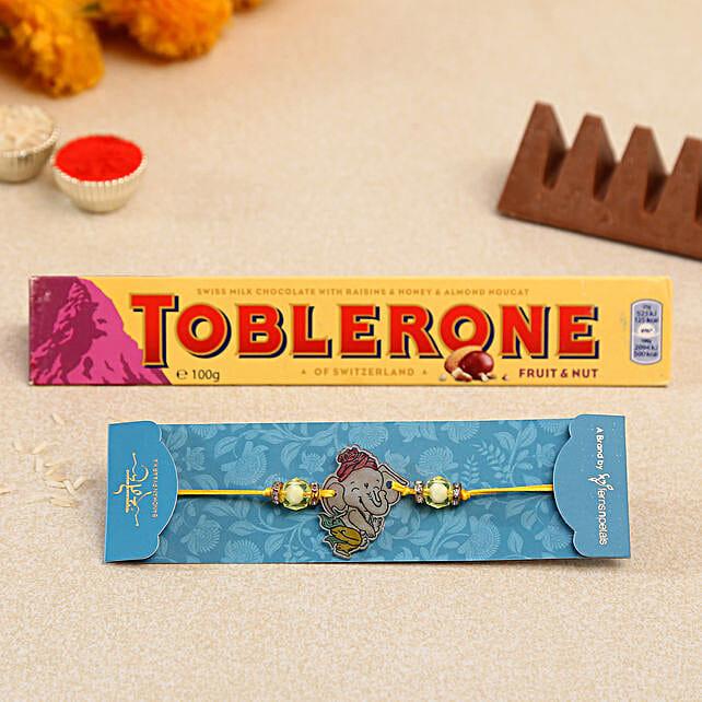 Divine Bal Ganesha Kids Rakhi And Toblerone Chocolate:Send Cartoon Rakhi to UAE