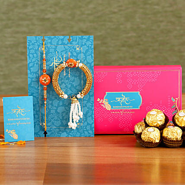 Orange Pearl And Lumba Rakhi Set With 3 Pcs Ferrero Rocher:Rakhi Sets To UAE