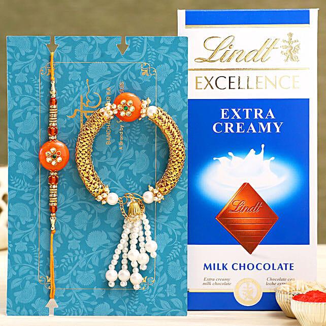 Orange Pearl And Lumba Rakhi Set With Lindt